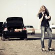 Young fashion woman with broken car calling for help — Stock Photo #48153669