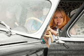 Young people driving retro car — Stock Photo