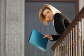 Happy young business woman with a folder at the office building — Foto de Stock