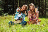 Happy young girls with a fruit basket on nature — Stock Photo