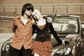 Young couple in love at the car — Stock Photo