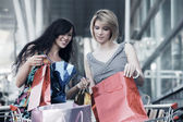 Young women with shopping cart — Стоковое фото