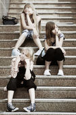 Group of teenage girls on the steps — Stock Photo