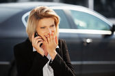 Young business woman calling on the cell phone — Stock Photo