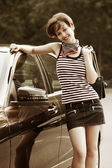 Happy young woman with a car — Stock Photo