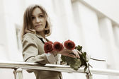 Young woman with a roses — Stock Photo