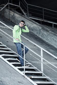 Young man standing on the steps — Stock Photo