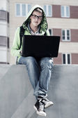 Young student using laptop — Stock Photo