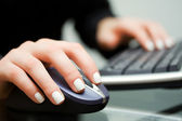 Female hands typing on computer keyboard — Stock Photo