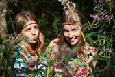 Two happy young girls in a summer forest — Stock Photo