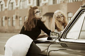 Young fashion women at the retro car — Stock Photo