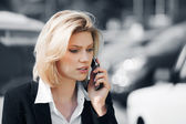 Young business woman calling on the mobile phone — Stock Photo