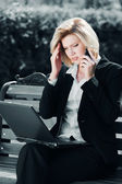 Tired businesswoman calling on the mobile phone — Stock Photo