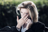 Sad woman calling on the phone  — Stock Photo