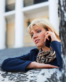 Young fashion woman calling on cell phone outdoor — Stock Photo