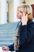 Young fashion business woman sitting on the steps — Stock Photo