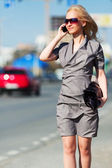 Young fashion woman calling on cell phone — Stock Photo