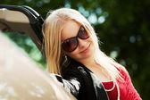 Happy young blond woman at the convertible car — Fotografia Stock