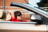 Young man driving convertible car — Stock Photo