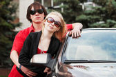 Happy young couple at the convertible car — Stock Photo