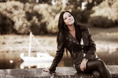 Young fashion woman in leather jacket outdoor — Stock Photo