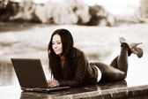 Young fashion woman using laptop outdoor — Stock Photo