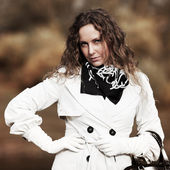 Portrait of fashion beautiful woman with long curly hairs — Stock Photo