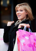 Happy young woman with shopping bags — Stock Photo