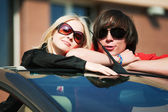 Happy young couple in a convertible car — Stock Photo