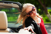 Happy young woman at the convertible car — Stock Photo