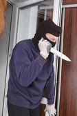 Murderer at home — Stock Photo