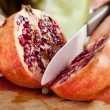 Stock Photo: Slicing pomegranate