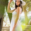 Beautiful womwith white sun hat — Stock Photo #40742423