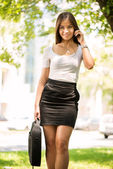 Businesswoman using a Cell Phone outoors — Stock Photo