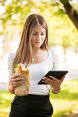Young Woman taking a break for breakfast — Stock Photo