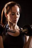 Young female exercising — Stock Photo