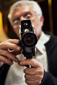 Senior man holding video Camera — 图库照片