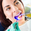 Stock Photo: Dental treatment with UV lamp