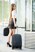 Businesswoman with suitcase — Stok fotoğraf