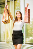 Happy girl with shopping bags — Stock Photo