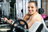 Young woman doing Biceps exercise — Stock Photo
