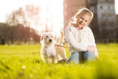 Little girl with her puppy dog — Stock Photo