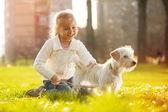 Little girl with her puppy dog — ストック写真