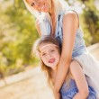 Mother and daughter in the nature — Stock Photo