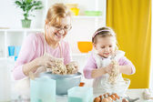 Little girl baker — Stock Photo