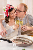 Happy couple in the kitchen — Stock Photo