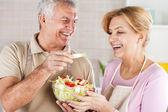 Senior Couple in the kitchen — Stock Photo