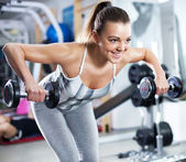 Young woman doing shoulder exercise — Stock Photo