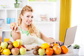 Young woman in a kitchen — Stock Photo