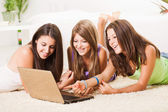 Three cheerful Friends with laptop — Photo